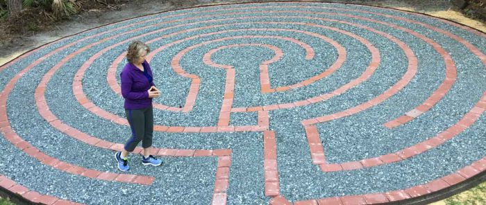 a woman walking a labyrinth