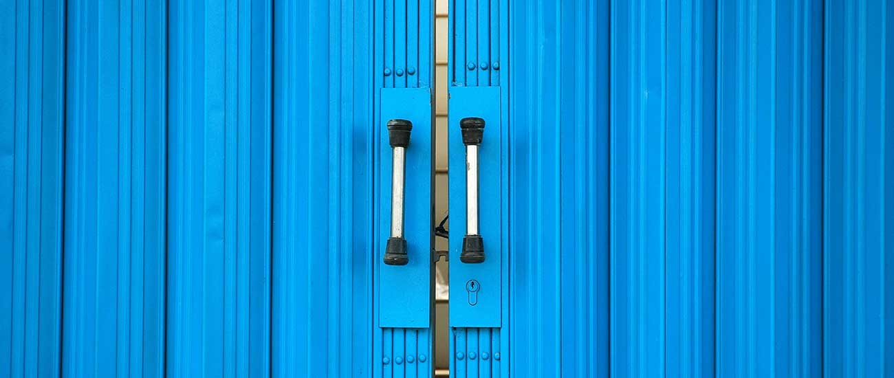 blue sliding doors with silver handles