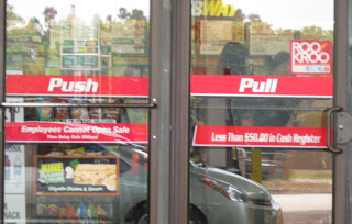 convenience stores doors with the words push and pull on the doors