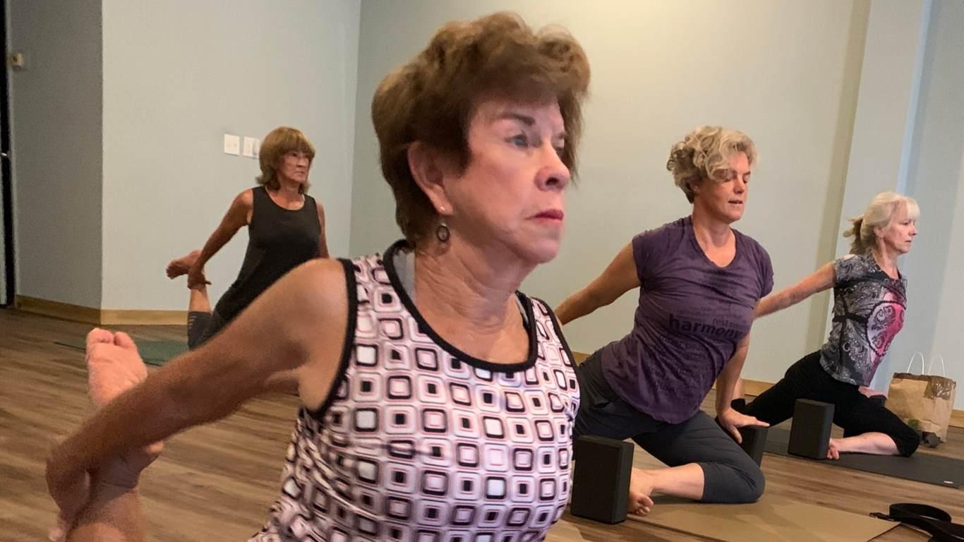 yoga class in pigeon pose