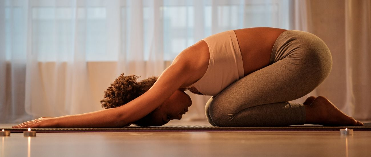 woman in balasana yoga child's pose